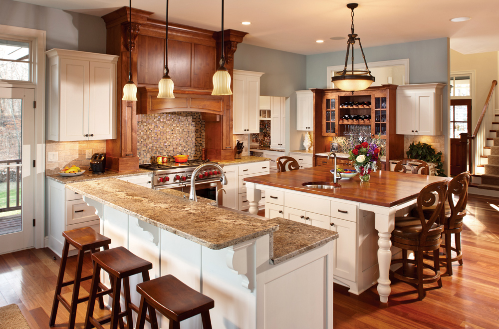 Allow extra room for dining with a large kitchen islands for Two level kitchen island