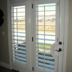 White French door with larger panels of shutters