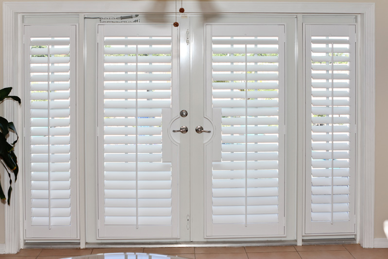 Cool and nice design of shutter for french doors homesfeed for Wood doors and shutters