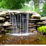 artificial mini waterfall with natural stone arrangement and mini natural pool