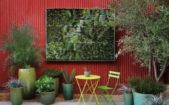 awesome nice adorable cool wonderful outdoor fence decoration with with red coloring concept design with green plant decoration with small table decoration