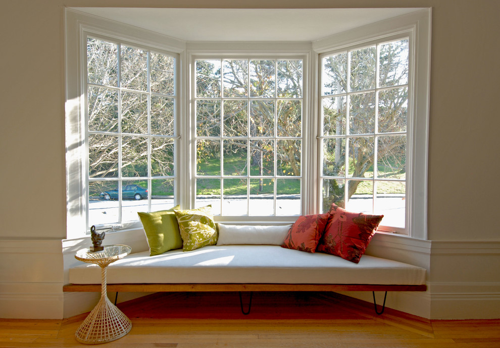 backless daybed under the bay windows bright