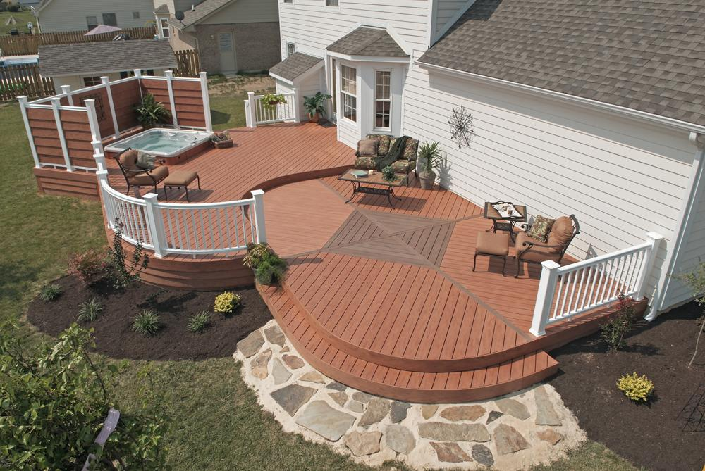 Backyard home deck with hot spa feature and some furniture for patio area white color