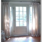 Beautiful White From Floor To Ceiling Curtain For Sidelight Windows An Elegant White Door With Transparent Glass Feature Laminate Wood Flooring Comfy White Living Room Furniture