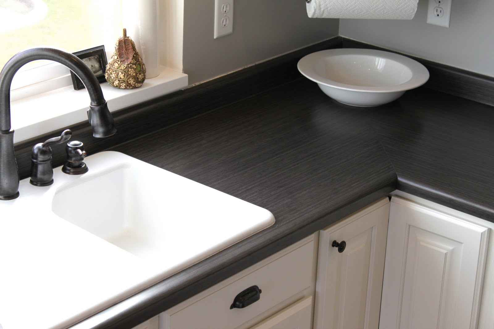 High Quality Black Wood Finish Kitchen Countertop With White Decorative Bowl A Luxurious  White Sink With Black