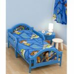 blue Toy Story theme bed furniture cute white round chair bright blue bedside table with white  table lamp a wecker in white solidwood floor
