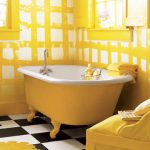 bright yellow tub with single water tap yellow-white wall paint decoration  bathing properties in yellow  black-white vinyl floor
