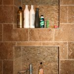 built-in shelves with  mosaic tiles as the back part