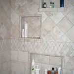 built-in shower shelves for bath supplies storage