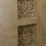 Built In Shower Shelves With Small Mosaic Tiles In The Back