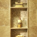 built-in shower shelviing unit with small tiles in the back
