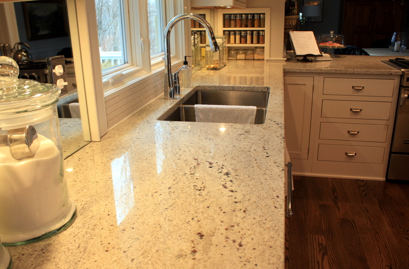 Cashmere White Granite Countertop With Double Deep Stainless Steel Sinks And A Single Faucet