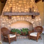 cedar mantel for fireplace with wood candle stands an outdoor ex-fireplace building with brick construction a pair of patio furniture in rattan material