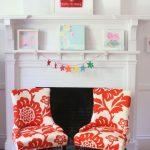 chairs for couple with red big floral patterns a white fireplace mantel with its beautiful and colorful decorations