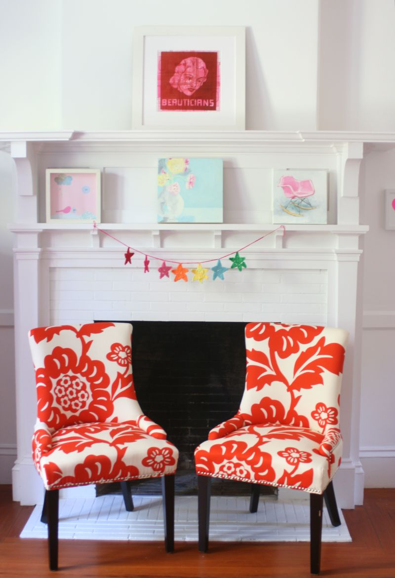 Chairs For Couple With Red Big Floral Patterns A White Fireplace Mantel Its Beautiful And