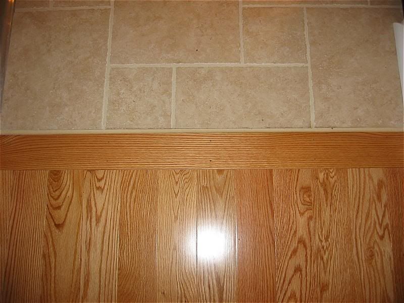 Tile to wood floor transition ideas homesfeed for Wood floor pieces