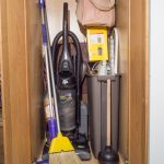 closet cabinet with top shelf for broom vacuum cleaner and other cleaning tools