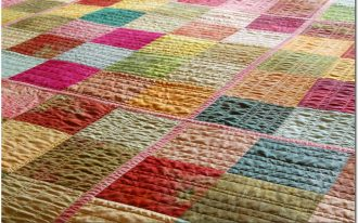 colorful square pattern quilt