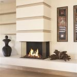contemporary gas fireplace with traditional touches such as a pile of timbers and ethnical paintings for wall decoration