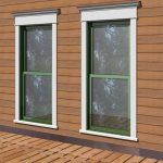 contemporary outside window trims surrounded by wood planks wall system