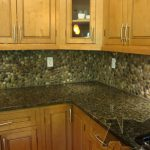 cool adorable nice wonderful fantastic nice river rock backsplash with modern concept design with wooden cabinet design