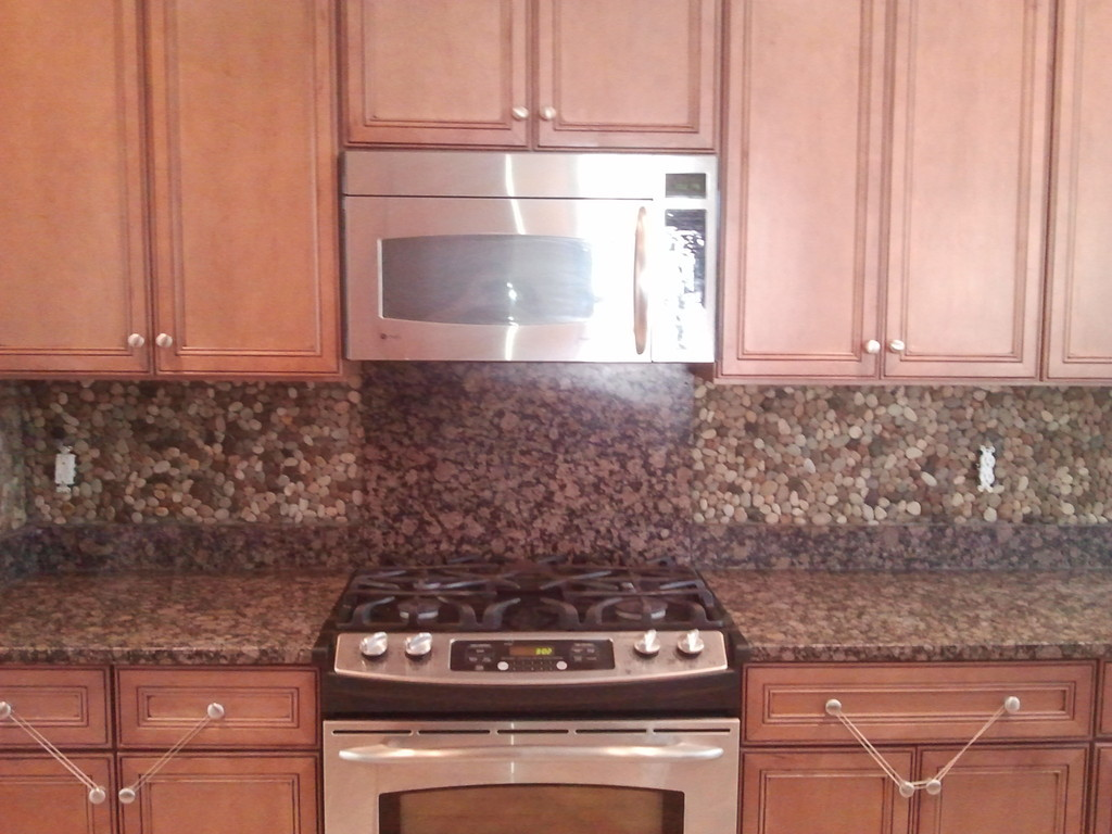 nice adorable fantastic river rock backsplash with amaing small rock