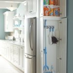 corner closet cabinet for broom and other cleaning tools in white color