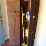 corner wood closet cabinet for broom and cleaning supplies in rustic color
