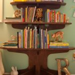 creative bookcase in tree shape a lot of books animal miniatures soft and smooth cream fury carpet