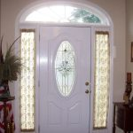 Curtain Sidelight In Front Door  White Wood Entry Door With Curved Top Part  A Classic Console As Entrance Furniture Round Wood Table With High Single Leg Plant Ornament Two Decorative Frames
