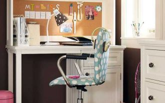 cute decoration of study desk for girl student with under cabinet drawer and top bookshelf in white color a blue movable chair with white polkadot patterns a cute pink trash container some ornaments