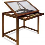 drafting stand-table with glass top panel and wide under drawer as the storage