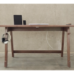 electrical cord behind the desk  a wood desk a headset unit mini audio system