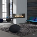 elegant and luxurious gas fireplace mantel comfy and smooth fury carpet in grey color some ball decoration as the additional seatings beautiful blue sofa with pillows