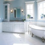 elegant bathroom with pale blue wall accent also alluring victorian bathtub also interesting marble top with white drawes in tile flooring concept