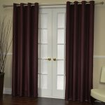 elegant dark curtain installation for French door dark wood planks flooring