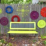 elegant simple nice decoration-grey-wood-fence-decorations-feat-colorful-round-shape-recycled-and-yellow-with-grey-combine-bench-colorful-cool-outdoor-fence-decorations-design with a small bench