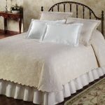 elegant white coverlet a kingbed furniture beautiful and expensive rug for bedroom classic wood-finishing console pretty ornamental flower arrangement