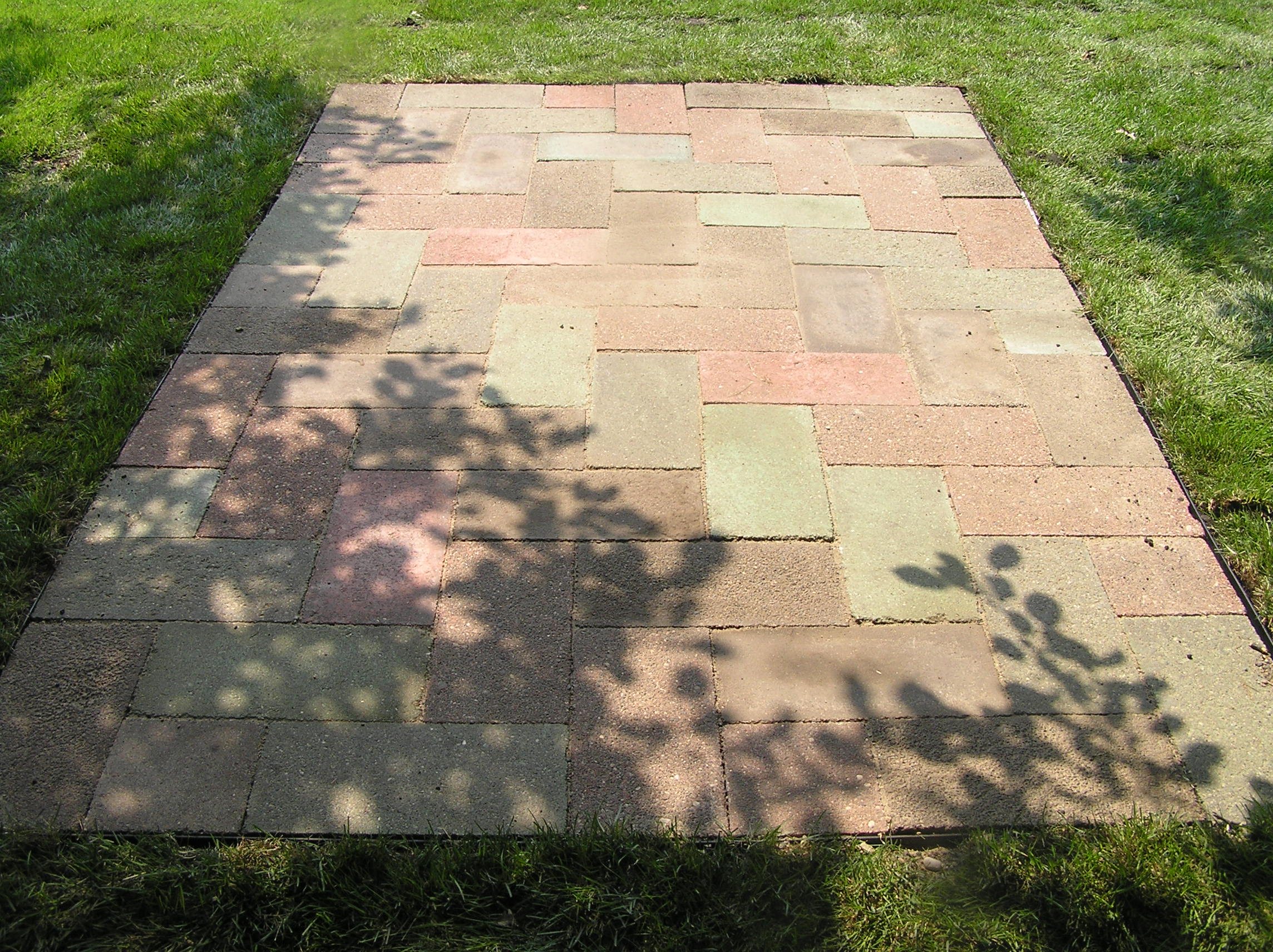 ... Floor Over Concrete A Black Rattan Chair In Patio · Fabricated Natural  Stones In Paver Shape