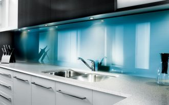 fair blue acrylic backsplash idea double stainless steel kitchen sinks and faucet water jar and two drinking glasses knives standing  bar-ceiling on kitchen white granite countertop