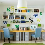 floating  bookcases with under double desks and  double blue chairs for kids book collections a computer unit twin green-cap table lamps  letter wall ornaments