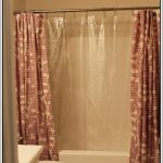 floral patterned-shower curtain a stainless steel shower curtain rod with ring clips