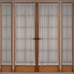 Full Sidelight Window Curtains In White Color In Two Wood Door Panels