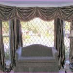 glamour bay window drapes in glossy black color decorative standing light with black fury decoration