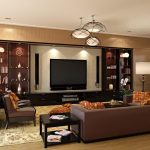 gorgeous brown leather sofa with elegant flower motif cushions also luxurious home theater set with large display cabinet with unique pendant lamp in lamiante flooring