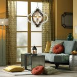 gray sofa colorfu cushion beautiful lighting fixtures morrocan accents stool creame and light blue wall lantern for candle place moroccan accents curtain moroccan living room