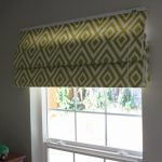 green Roman window shade with cut-diamond shape pattern
