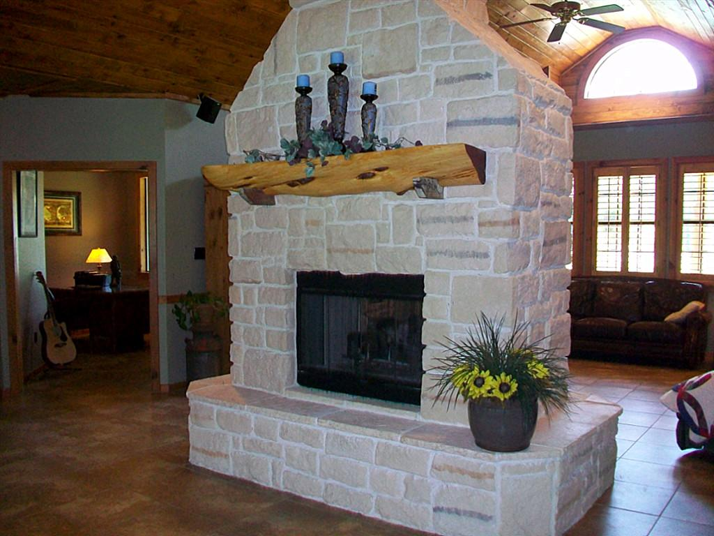 Create a rustic style on your fireplace with cedar mantels for Fireplace half stone