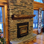 half-log gas fireplace frame made from cedar a gas fireplace construction with natural stone wall system brushed-wood floor