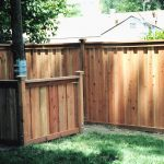 hidden pool equipment room with solid wood fence system